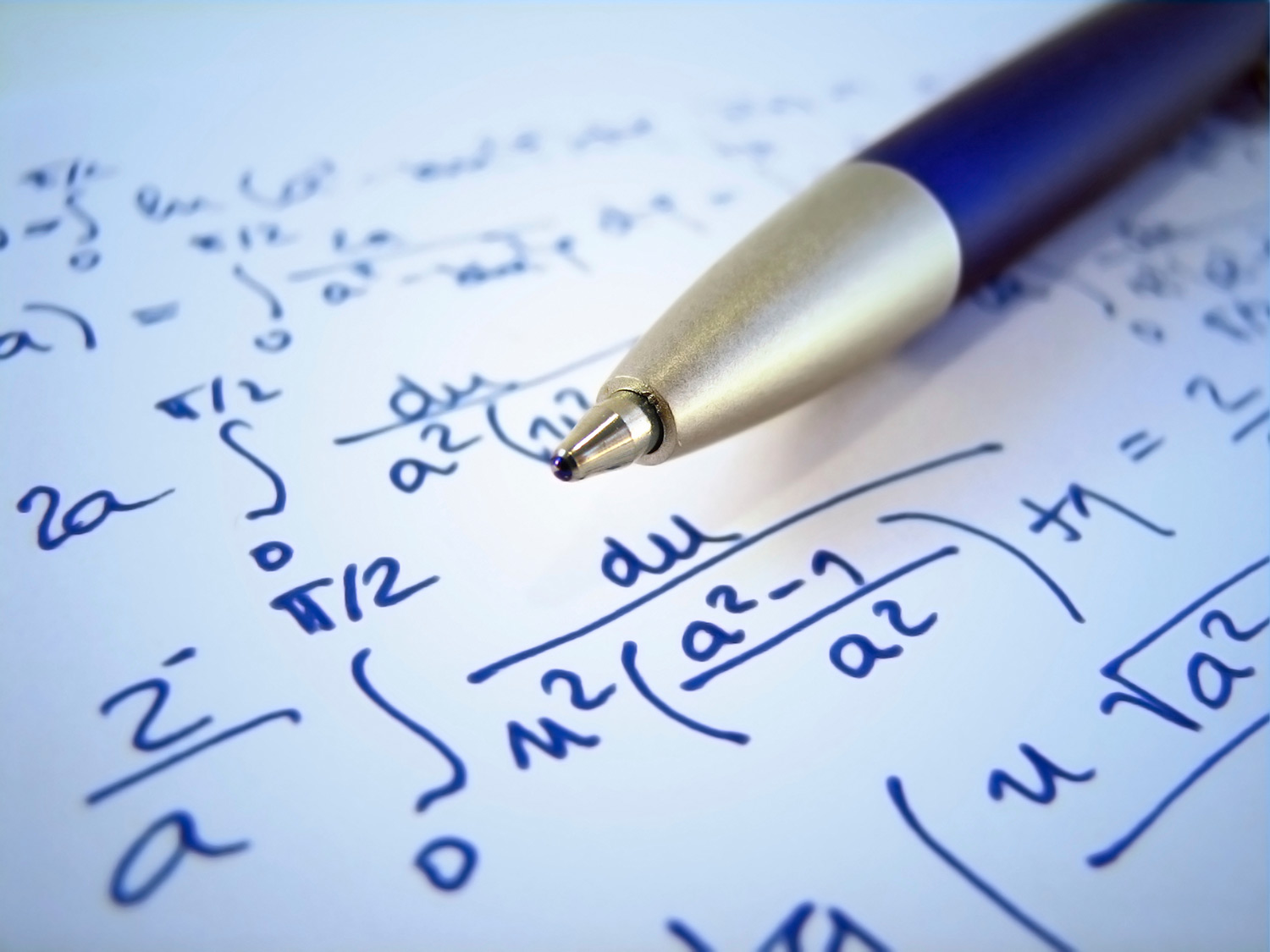 Pen and notebook with math equations